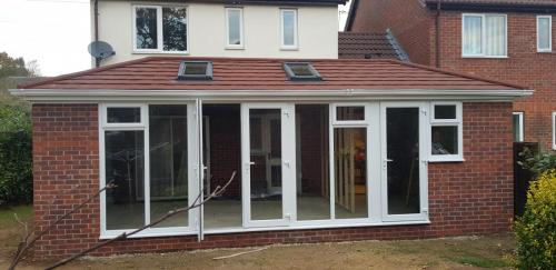 Double hipped Edwardian solid roof conservatory with concrete and brick system